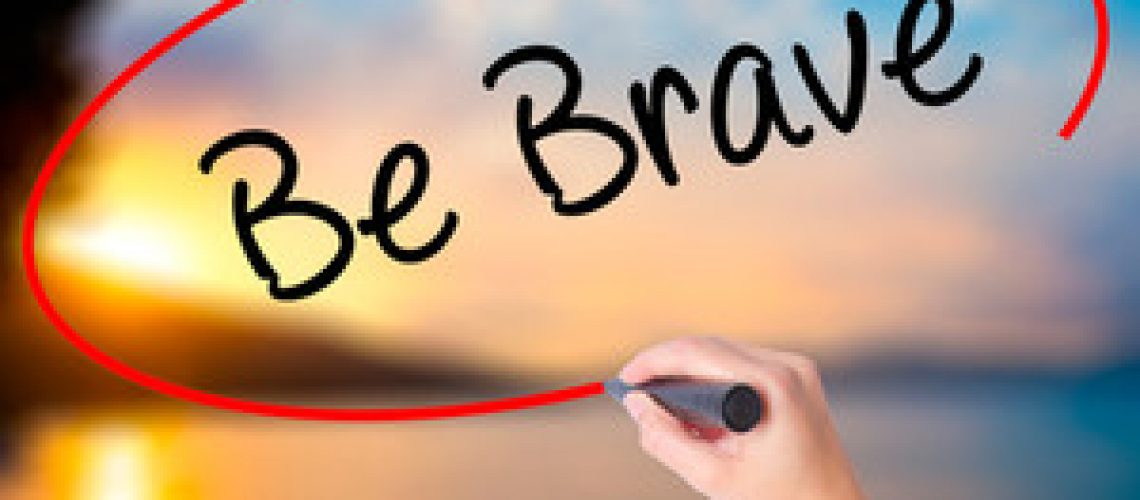 graphicstock-women-hand-writing-be-brave-with-black-marker-on-visual-screen-isolated-on-sunset-business-technology-internet-concept-stock-photo_BRV2eh7lUb_thumb